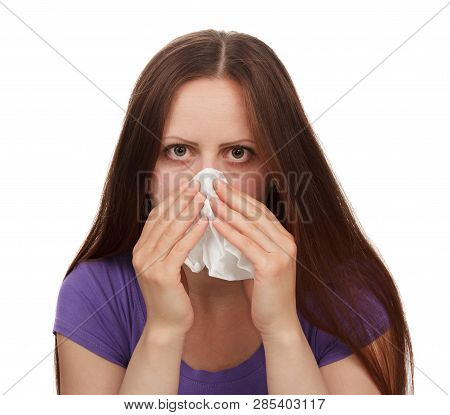 Young Woman Suffering With Allergy Isolated On White Background. The Concept Of The Problem Of Aller