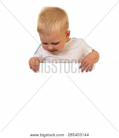 Little Boy Looking Over A Blank Banner Isolated On White Background