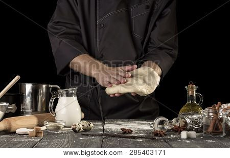 Cook In A Dark Jacket Preparing Delicious Yeast Dough For Bread