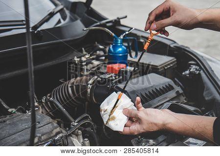 Services Car Engine Machine Concept, Automobile Mechanic Repairman Hands Checking A Car Engine Autom