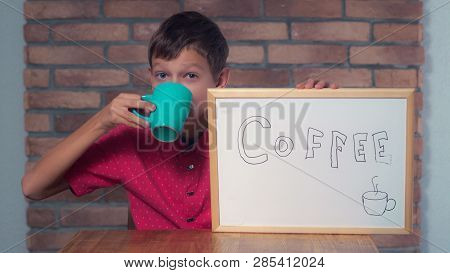 Portrait Little Boy Showing Whiteboard With Handwriting Word Coffee. Child Holding Big Cup And Drink