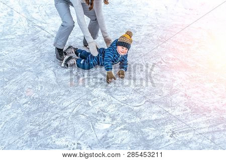 Young Mother Woman Raises Son Boy 4-6 Years Ice In Winter In City Park. The Concept Of First Lesson