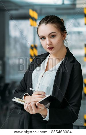 Personal Assistant Portrait. Business Matters Planning. Young Woman Making Notes Listening To Virtua