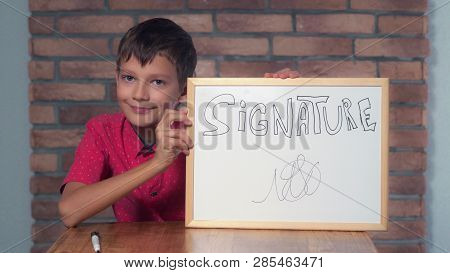 Portrait Little Boy Showing Whiteboard With Handwriting Word Signature Child Put A Signature. Preado