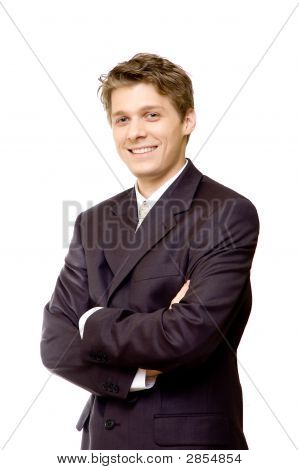 Handsome Young Businessman Smiling With Crossed Arms