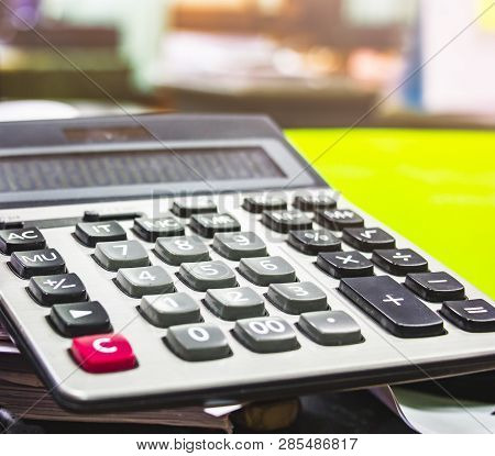 Close Up Button Calculator , Calculator On Paper Messy And Cluttered Office Desk