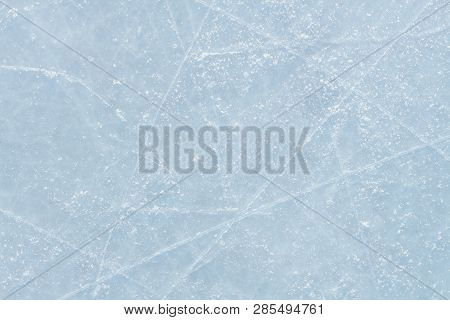 Ice Hockey Rink Scratches Surface Abstract Background.