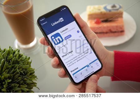 Alushta, Russia - November 6, 2018: Woman Hand Holding Iphone X With App Apple Store And Linkedin In
