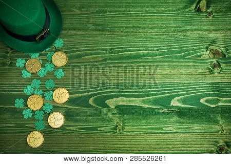 Happy St Patricks Day Leprechaun Hat With Gold Coins On Vintage Green Wood Background