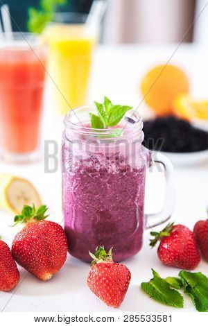 Blueberry Smoothies On A White Background With Berries A