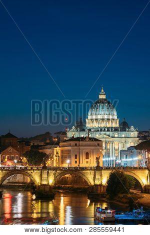 Rome, Italy. Papal Basilica Of St. Peter In The Vatican And Aelian Bridge In Evening Night Illuminat