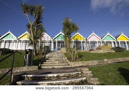 A Row Of Beach Huts At Weymouth, A Town In Dorset On The South Coast Of England, Uk.