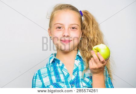 Kid Girl Eat Green Apple Fruit. Vitamin Nutrition Concept. Reasons Eat Apple Every Day. Nutritional