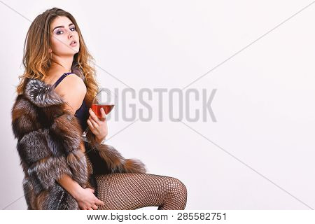 Perfect Woman Luxurious Appearance. Woman Seductive Model Enjoy Wine Wear Luxury Fur And Elite Linge