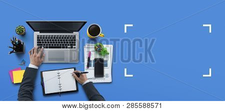 Office Workplace With Laptop, Notebook, Hand, Office Supplies, On Blue Background. Solution, Busines