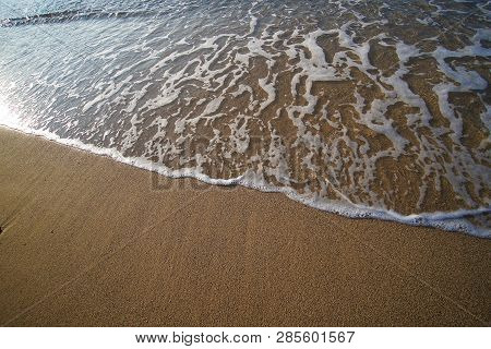 Graphic Composition Drawn By The Sea On The Golden And Unique Sand Of Lia Beach In Mykonos, Greece