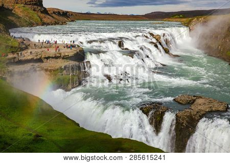 Tourists at the Gullfoss (Golden Falls) waterfall on the Hvíta river, a popular tourist attraction and part of the Golden Circle Tourist Route in Southwest Iceland, Scandinavia