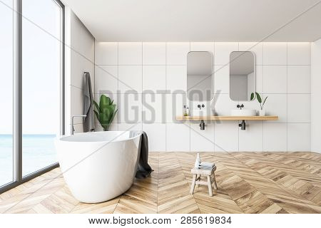Side View Of White Tile Bathroom, Tub And Sinks