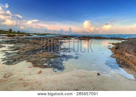 Scenery of Caribbean Sea coast near Playa del Carmen at sunset, Mexico