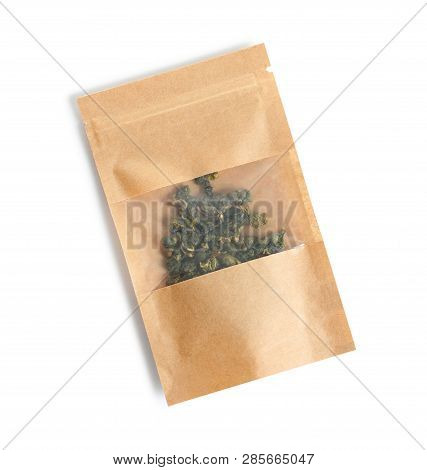 Craft Paper Bag With Tie Guan Yin Oolong Tea On White Background, Top View