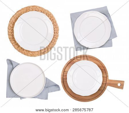 White empty plates on napkins and wooden board isolated on white, top view