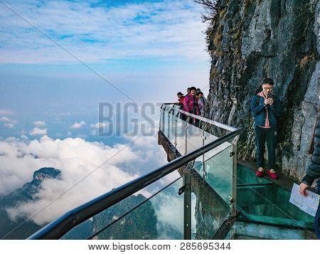 Zhangjiajie/china - 15 October 2018:unacquainted Tourists On Glass Cliff Walk In Tianmen Mountain At