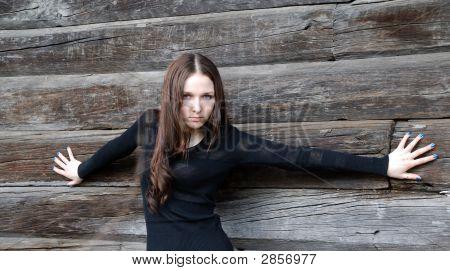 Teenage Girl Near Timber Wall