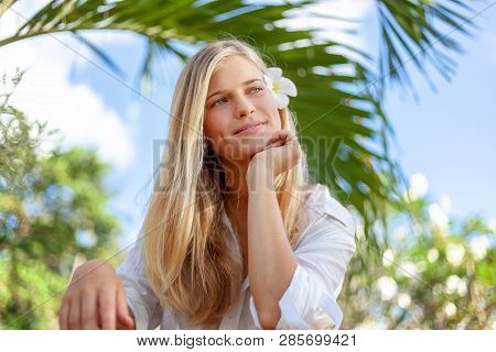 Beautiful Blonde Teen Girl, Beauty Face Care. Spring And Summer Season. Tropical Flower In Hare