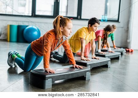 Kids Using Step Platforms While Doing Push-up Exercise