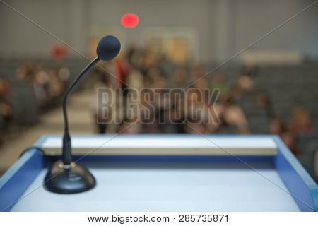 Speaker Prepare Before Speaking To The Audience Behind The Podium Focused Microphone On The Podium A