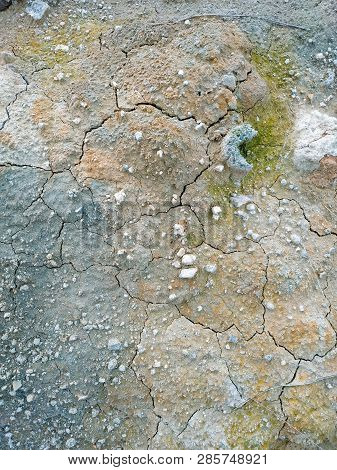 Surface Of A Grungy Dry Cracking Parched Earth
