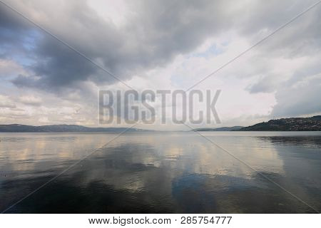 Sunset On The Lake. Beautiful Sunset Nature. Evening Landscape. Clouds Over The Lake. The Horizon At