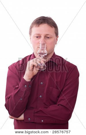 Man Is Smelling At A Glas Of Grappa