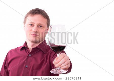 Man Is Holding A Glass Of Red Wine