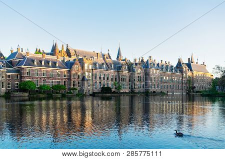 Facade Of Binnenhof - Dutch Parliament With Reflections In Pond Still Water, The Hague, Holland