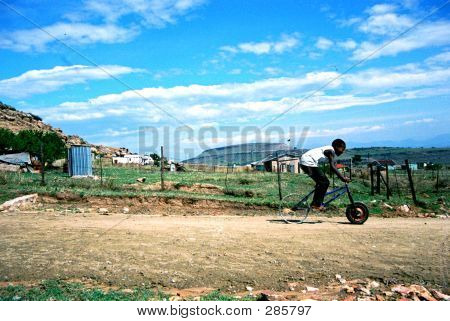African Boy On Bike