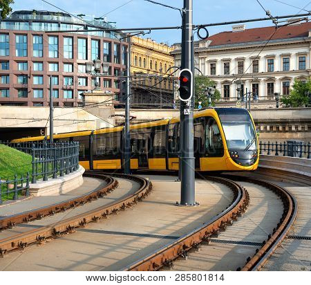 Modern Yellow Tram Driving Out Of The Tunnel In Budapest