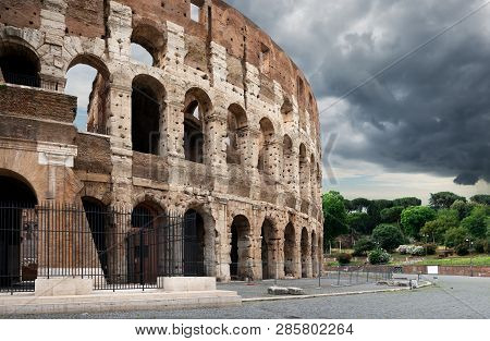 Gray Thunder Clouds Over Colosseum In Summer Rome