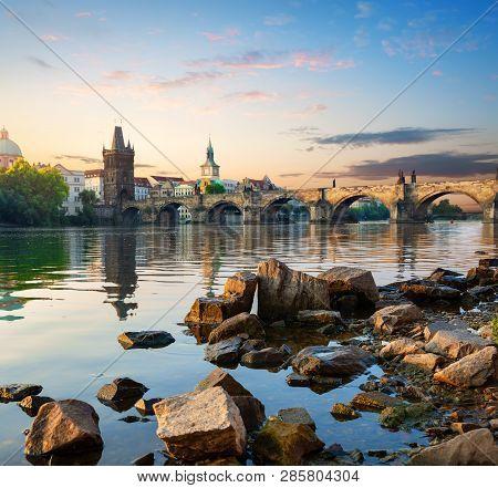 Stones On The Riverbank Of Vltava Near Charles Bridge In Prague
