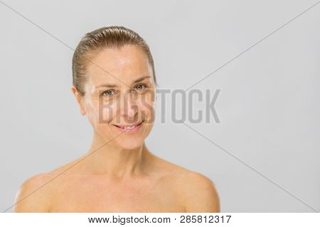 Beautiful smiling middle aged woman. Skin care