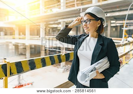 Portrait Of Adult Female Builder, Engineer, Architect, Inspector, Manager At Construction Site. Woma