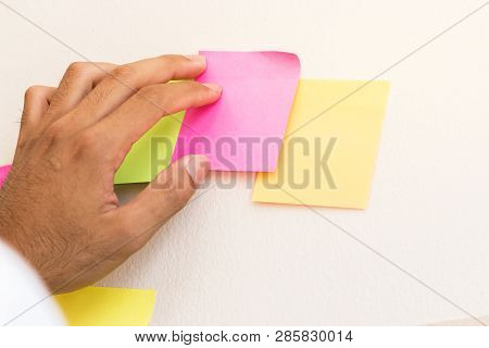 Business People Hands Post Sticky Note Paper On Glass Reminder Schedule Board For Meeting At Office