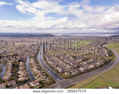 Aerial shot of Folsom, California with Folsom Lake in background.