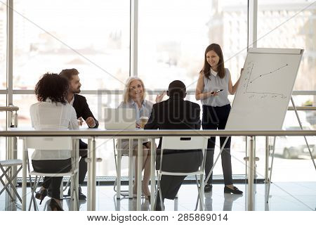 Diverse Businesspeople Sitting In Boardroom Discussing Listening Young Coach
