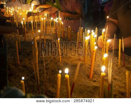 People Putting Burning Incense And Candle Into Pots In Makha Bucha Day