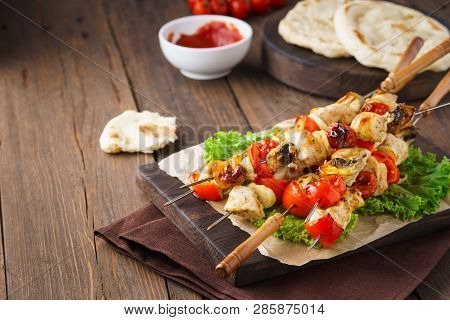 Turkey Or Chicken Skewers With Mushrooms And Vegetables. Mediterranean Food Concept With Sauce And P
