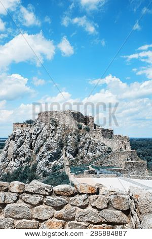 Famous Castle Devin With Blue Cloudy Sky. Slovakia, Central Europe. Teal And Orange Photo Filter.