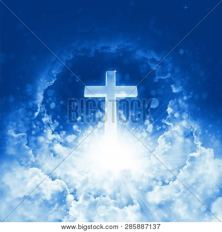 Concept Of Christian Religion Shining Cross On The Background Of Cloudy Sky. Divine Shining Heaven.