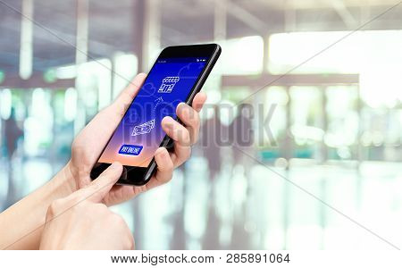 Hand Holding Mobile With Pay Word And Bill Icon Feature With Blur Back Office Counter Background,dig