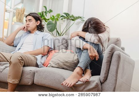 Sadness Young Asian Wife Having Quarrel And Sitting On Sofa After Fight With Husband Behind Her In H